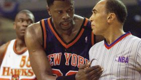 Patrick Ewing (C) of the New York Knicks argues wi