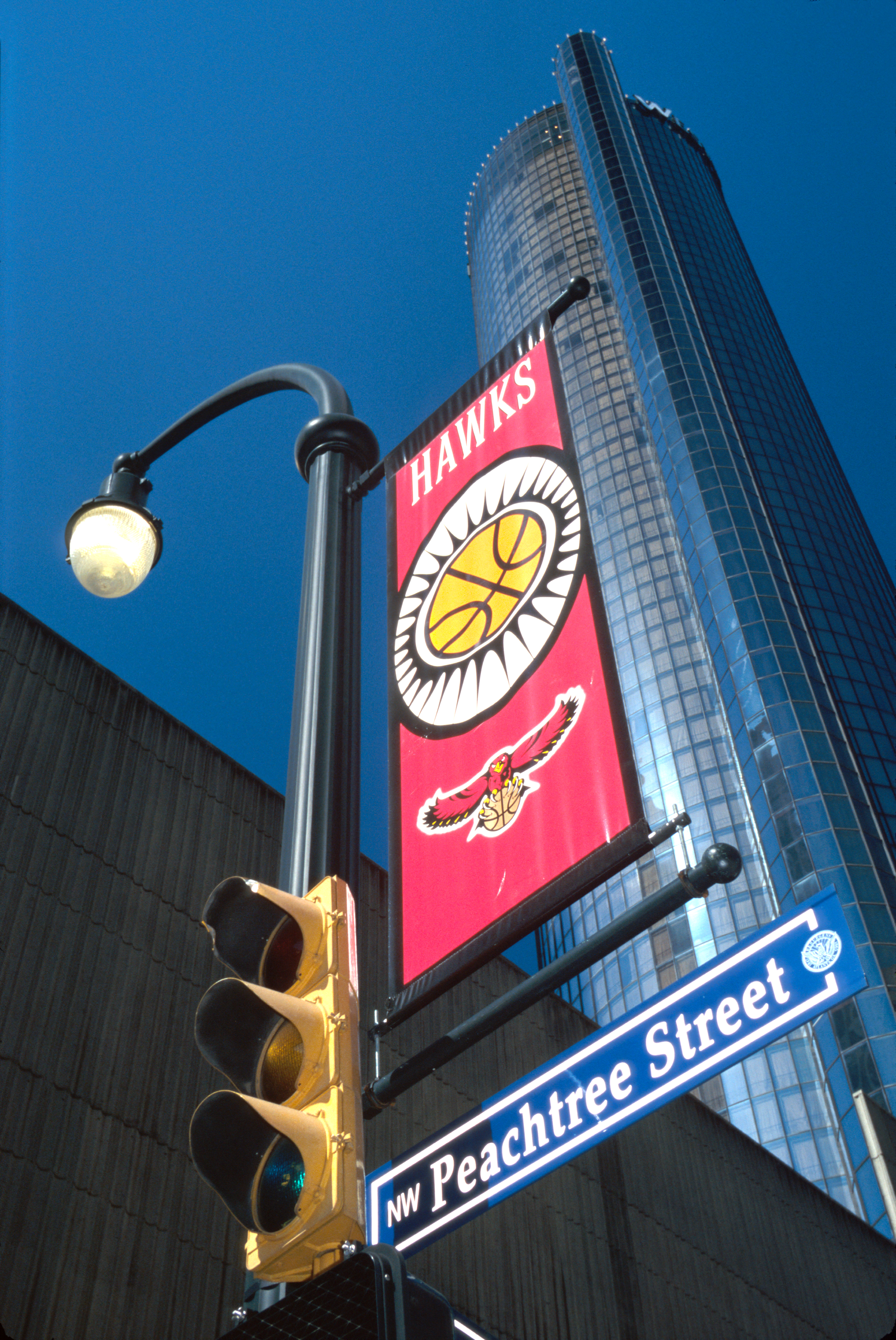 Peachtree Street sign and banner for Hawks National Basketball Association team.