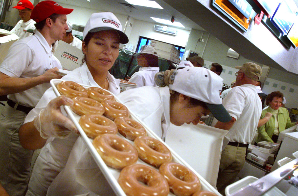 Maple Grove, MN. 4/23/02--Krispy Kreme made it's arrival this morning in Maple Grove. There were nearly 500 waiting in line when the doors opened at 5:30AM. A few had been there all night long. Krispy Kreme expects to sell at least a million doughnuts to