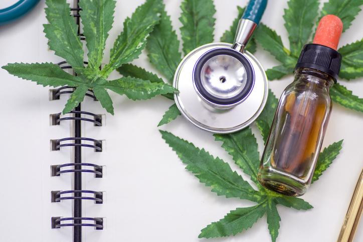 Marijuana research, The doctor holds a bottle of marijuana.