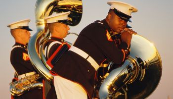 Marines with tubas preparing to march