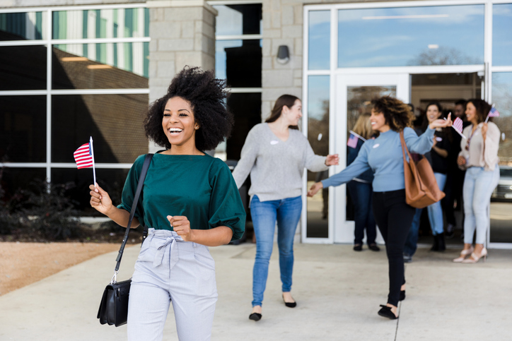 Women leaving polling place are happy to have voted