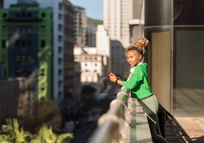 African woman looking over the cityscape