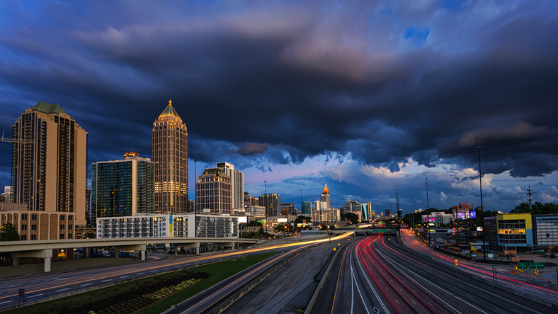 Atlanta skyline during rush hour and a stormy night